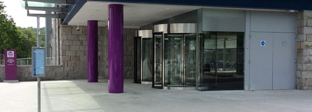 A pair of EA framed revolving doors installed at a university building