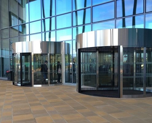 Two high capacity revolving doors at a university building