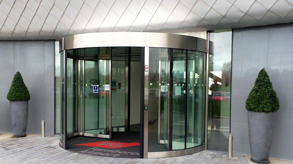 A high capacity revolving doors at an airport terminal building