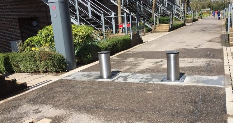 Security bollards protecting the entrance road of a university campus