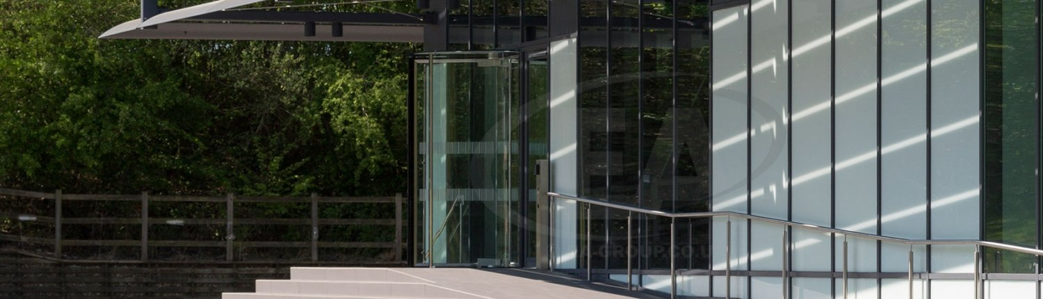 An all glass revolving door, manufatured and installed by EA Group